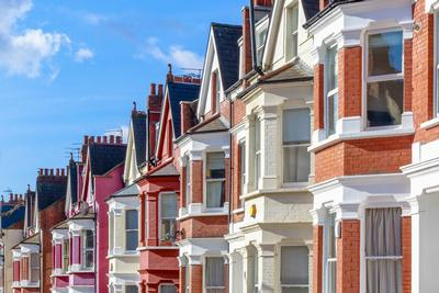 Mortgage Advisor in Birmingham and Wolverhampton. Building insurance. Colourful row of British homes.